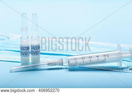 Injection Syringe, Needle, Medical Mask, Close Up. Vaccine Medical Concept Covid-19