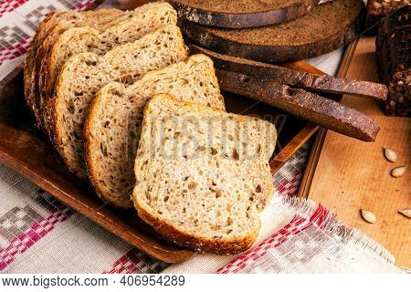 Slices of wheat and oat flakes bread and rye bread.