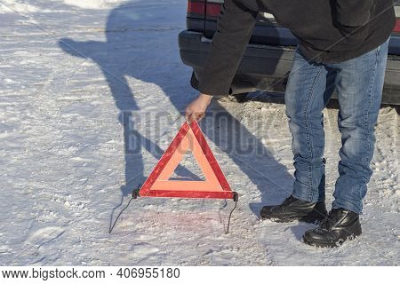Street Lighting. White Snow. The Man Puts An Emergency Sign. Damage To The Vehicle