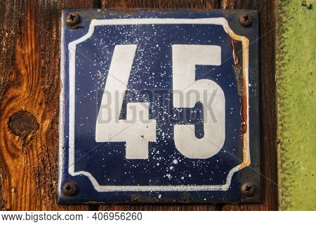 Weathered Grunge Square Metal Enameled Plate Of Number Of Street Address With Number 45