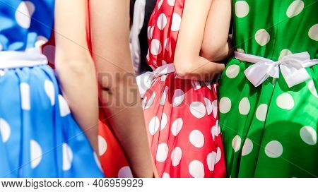 Close-up Of Girls Dressed In Fashionable Bright Retro Dresses In Dots. Fragment Of Well Dressed Wome