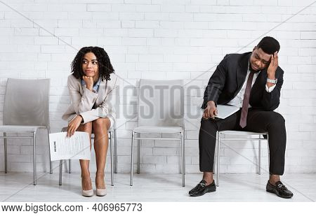 African American Man And Woman Feeling Exhausted From Waiting For Job Interview At Office Hall. Blac