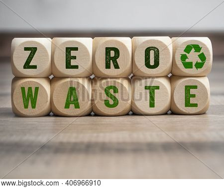 Cubes, Dice Or Blocks With Zero Waste And Recycling Logo On Wooden Background