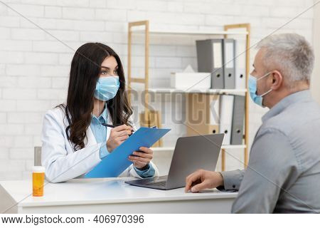 Diagnosis, Examination, Prescription And Medications. Millennial Lady In White Coat And Protective M