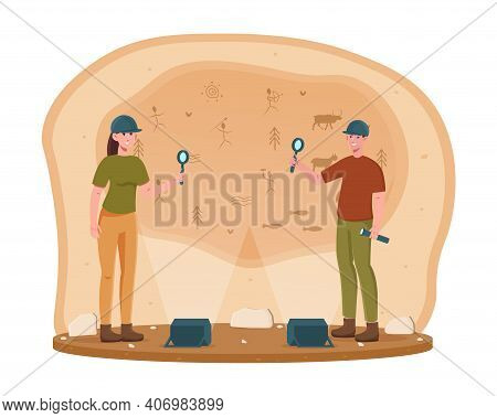 Two Young Archeological Discovering Cave Paintings. Male And Female Archeologists Examining Ancient