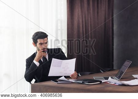 Young Businessman Working At Home And Thinking Of Something