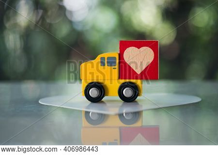 Cute Toy Car Delivering Heart For Valentine's Day. Concept Of Valentine's Day.