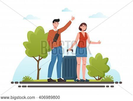 Young Couple With Luggage Standing Near Road And Hitchhiking. Couple Of Backpackers Travel Hiking A