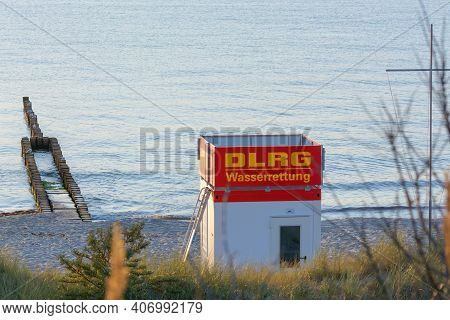 Zingst, Ostsee, Germany - July 29, 2018:\n\nbay Watchtower On The Beach At High Tide In Front Of A B