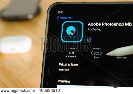 Adobe Photoshop Mix Logo Shown By Apple Pencil On The Ipad Pro Tablet Screen. Man Using Application