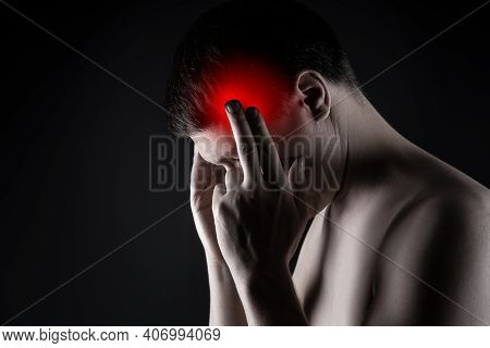 Headache And Migraine, Man With Head Pain On Black Background