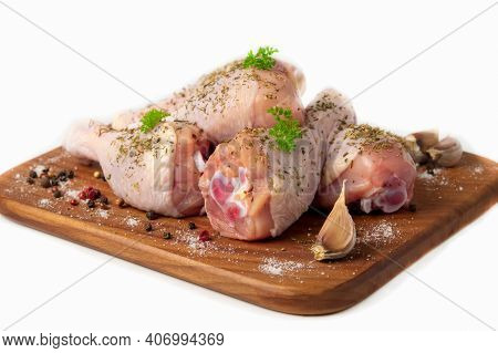 Raw Chicken Drumstick On A Wooden Cutting Board, Spices For Cooking Chicken Drumsticks, Parsley, Pep