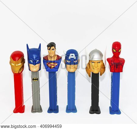 West Islip, New York, Usa - 5 February 2021: A Collection Of Pez Despenser Superhero Charecters From