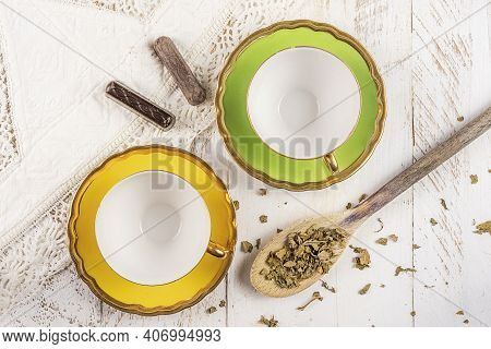 Two Empty Yellow Teacup On White Wooden Background