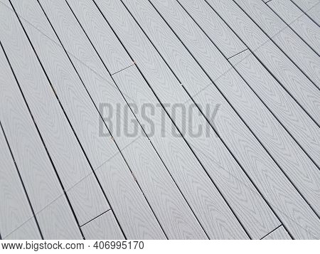 Grey Artificial Or Composite Wood Boards On Deck With Lines