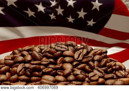 Roasted Coffee Beans On The Background Of The American Flag. Concept: The Best Flavored Coffee