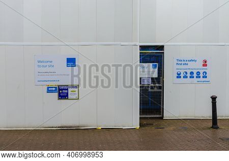 Chester; Uk: Jan 29, 2021: Safety Notices Are Displayed Prominently On Plain Hoardings Around A Buil