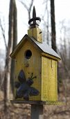 yellow bird house feeder poster