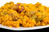 Closeup view of paella, side view of plate, typical Spanish cuisine poster
