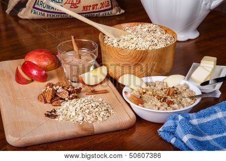 Preparing Oatmeal With Spices Nuts And Fruit