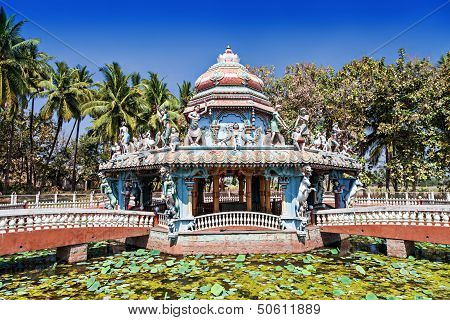 Beauty hindu temple stands on pond with lillies poster
