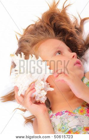 Tranquil Little Girl With Seashell