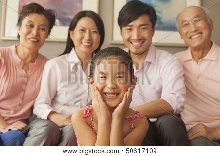 Multigenerational family smiling, portrait