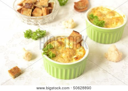Cauliflower baked in omele twith croutons, horizontal poster