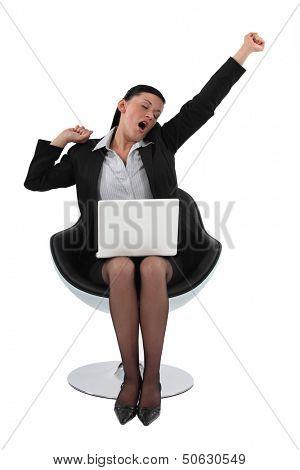 Businesswoman yawning