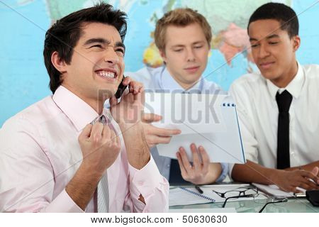 Young businessman rejoicing