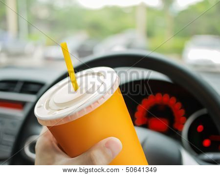 Driver Drinking Water In The Car