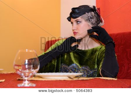 Girl At The Table