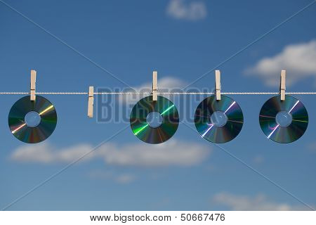 Four Cds On A Clotheslines