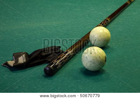 Billiard Table, Balls, Cue And Glove On Green Cloth