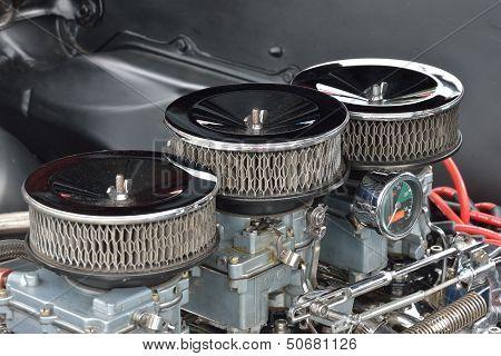 Three carburetor close up