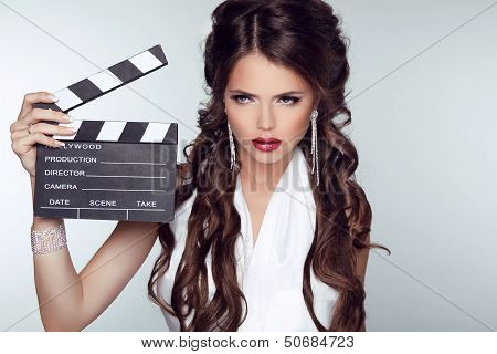 Fashion Woman With Sexy Red Lips Holding Cinema Clap. Super Star Model Shot