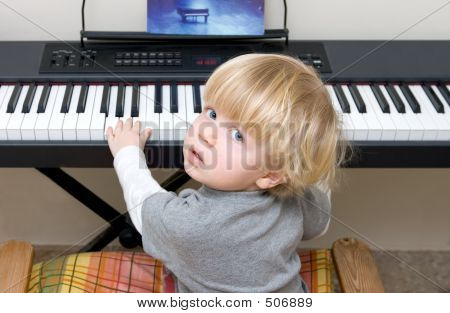 Young Boy Playing Piano Or Keyboard