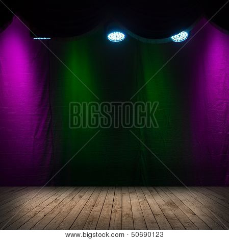 Dark scene interior with spotlights wooden stage and colorful background poster