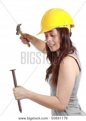 Girl Nailing Big Nail With Small Hammer