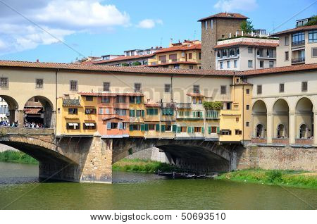 Picturesque view on colorful Ponte Vecchio over Arno River in Florence, Italy