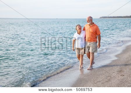 Seniors Walking On The Beach