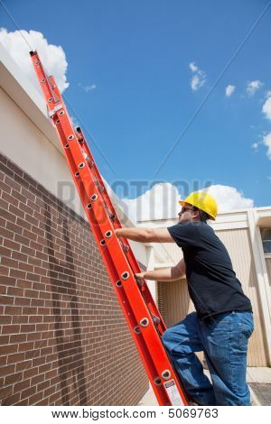 Construction Worker Climbs To Roof