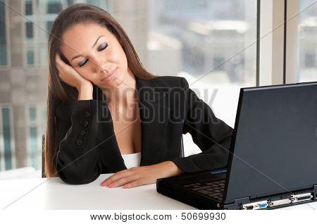 Businesswoman Sitting At Her Desk Sleeping