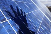 A little human touch adds to this industrial solar panels. poster