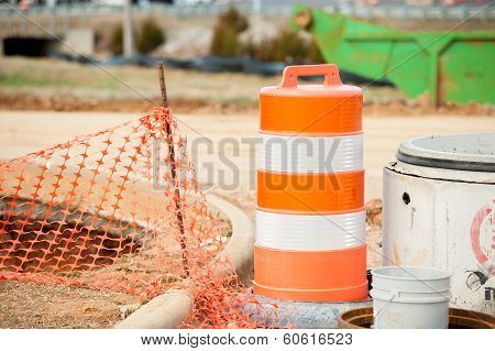 orange warning cones at construction site