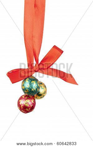 Xmas Balls Hanging On Celebratory Ribbon