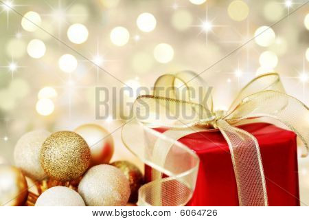 Christmas Gift On Defocused Lights Background