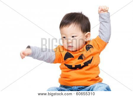 Asian baby boy with halloween dressing and hand up