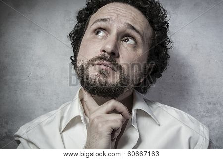 Male decisionmaking, man in white shirt with funny expressions