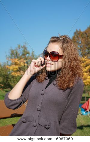 Girl Speaks By Phone In The Afternoon